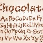 Dark chocolate alphabet on a white background. — Stock Vector #8625002