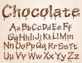 Dunkle schokolade alphabet auf weißem hintergrund. — Stockvektor
