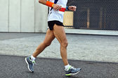 Man running in city marathon, blurred motion — Stock Photo
