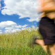 Stock Photo: Man cross country running on trail