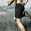 Man running cross country on trail — Stock Photo