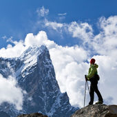 Woman hiking in Himalaya Mountains, sport and fitness travel — Stock Photo