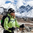 Stock Photo: Woman hiking in Himalaya Mountains
