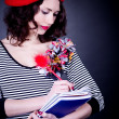 Frenchwoman student in red beret with notebooks — Stockfoto