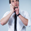 Happy man answering the phone — Stock Photo