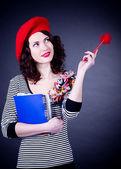 Estudiante francesa en boina roja con los portátiles — Foto de Stock
