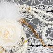 Stock Photo: Vintage lace with flowers and beads on white background
