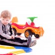 Baby boy with a big car on white background — Stock Photo #10078176