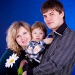 Beautiful young family with baby boy and flower — Stock Photo #10078260