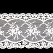 Stock Photo: Vintage lace with flowers on white background