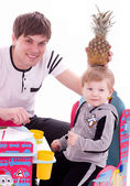 Joyful father and his baby son with pineapple — Stock Photo