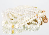 Vintage lace and beads on white background — Stock Photo