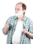 Portrait of mature handsome man shaving his beard — Stock Photo