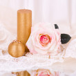 Romantic still-life with white candle and roses - Stok fotoraf