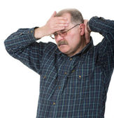 Portret starego mężczyzny o ból głowy — Zdjęcie stockowe