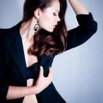 Beautiful young woman on dark background — Stock Photo #10484642