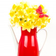 Beautiful spring flowers and butterfly in a red teapot — Stock Photo #10490202