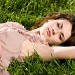 Beautiful woman in spring green grass — Stock Photo #10490873