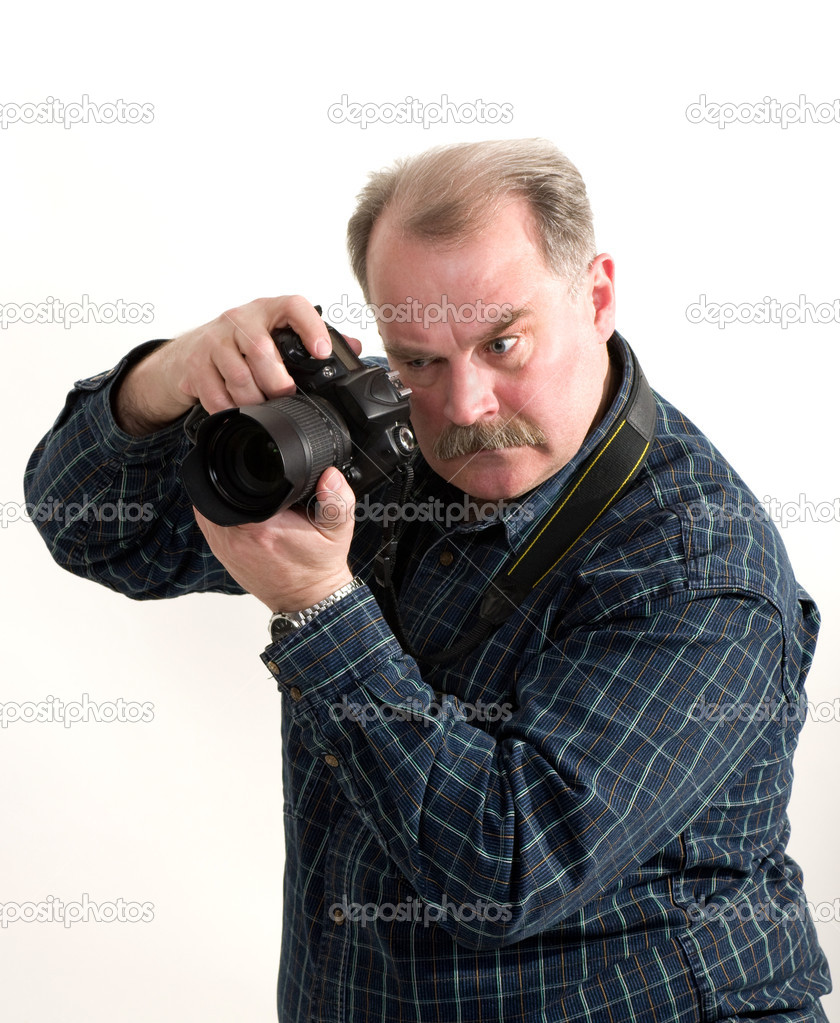Portrait of a old man with camera on white background ...