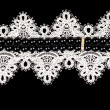 Vintage lace with flowers on black background — Stock Photo