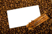 Brown coffee with cinnamon and spices on copyspace — Stock Photo