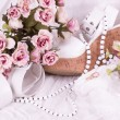 Vintage lace with flowers, shoe and wedding rings on white background. — Stock Photo