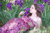 Beautiful woman in spring violet taffies — Stock Photo