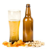 Beer green bottle and potato chips, pistachios — Stock Photo