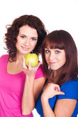 Girls with apple on white background — Stock Photo