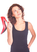 Beautiful smiling girl with red shoe on white background — Stock Photo