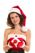 Woman in Santa Claus clothes with gift — Stock Photo