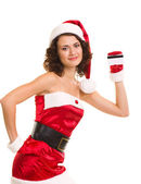 Woman in Santa Claus clothes with credit card — Stock Photo