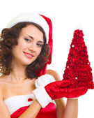 Woman in Santa Claus clothes with tree — Stok fotoğraf
