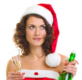 Woman in Santa Claus clothes with champagne bottle — Stock Photo