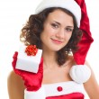 Young woman in Santa Claus clothes with gift — Foto de Stock