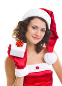 Young woman in Santa Claus clothes with gift — Stock Photo