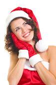 Young woman in Santa Claus clothes — Stok fotoğraf