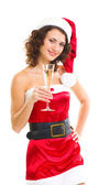 Woman in Santa Claus clothes with champagne glass — Stock Photo