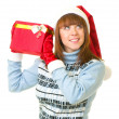 Stock Photo: Beautiful young girl in Santa Claus clothes with gifts