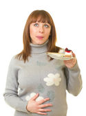 The beautiful young woman eat tasty cake — Stock Photo
