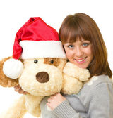 Woman in Santa Claus clothes with toy dog — Stock Photo