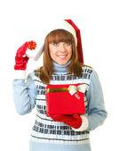 与礼物的圣诞老人衣服美丽的年轻女孩 — 图库照片