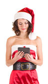 Girl in Santa Claus clothes with notebook — Stock Photo