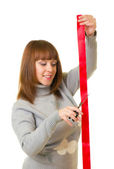 Young woman with red ribbon — Stock Photo