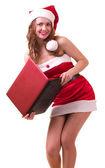 Flicka i santa claus kläder med bärbar dator — Stockfoto