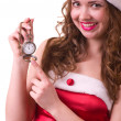 Woman in Santa Claus clothes with Clock — Stockfoto #8312302