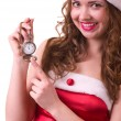 Woman in Santa Claus clothes with Clock — Stock fotografie