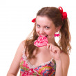 Beautiful young girl with pink spiral lollipops — Stock Photo