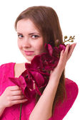 Young girl with orchid on white background. — Stock Photo