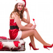 Woman in Santa Claus clothes dreaming about vacation — Stock Photo